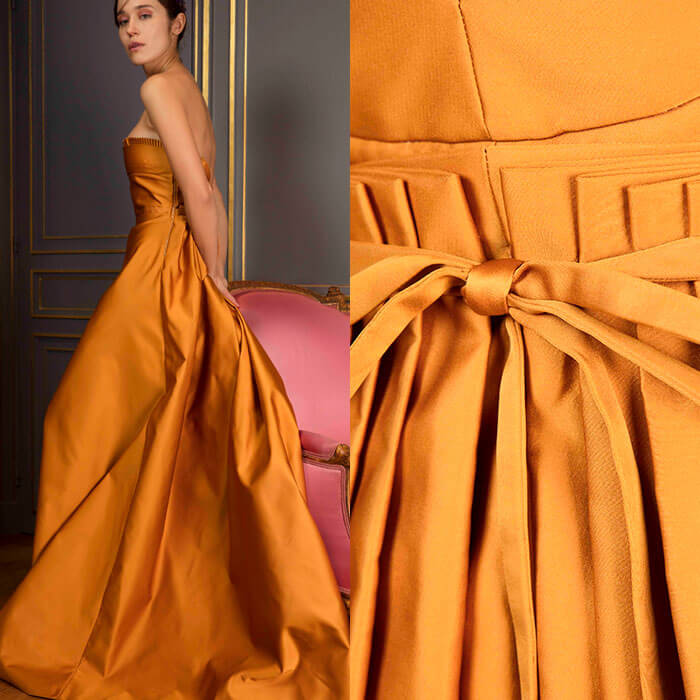 Saffron-Yellow bustier gown in duchesse-satin with a French-pleated bodice ruffle, and voluminous pleated skirt with a waterfall train.